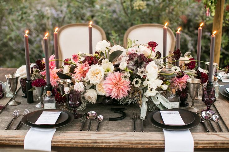 Charcoal gray, driftwood, and plum with hints of blush fall wedding color palette.