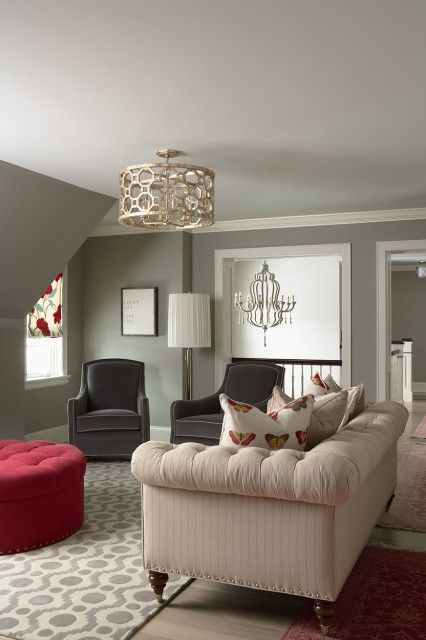Traditional meets contemporary in this comfy, modern neutral-toned family room (via Martha OHara Interiors)
