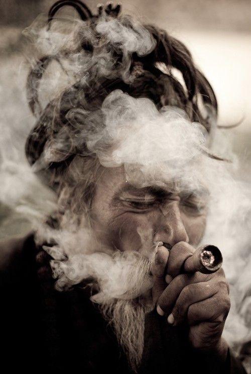 Hindu man is smoking ganja in chillum after Maha Shivaratri festival in Katmandu-Nepal.
