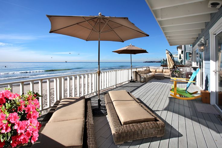 Back Patio Deck: New England Architecture, New England style, Colonial, Cape Cod, traditional, classic, beach architecture, beach style, beach organic, wood overhang, wood siding, outdoor wall light, large wood windows, large wood patio deck, wood railing, stairs going down to beach.