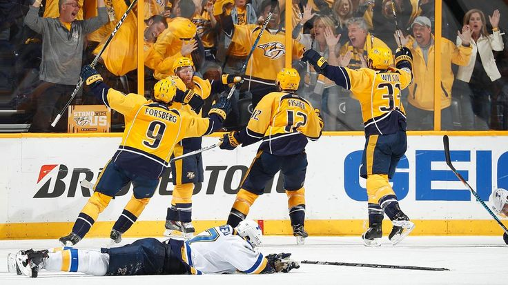 Nashville, TN - May 2: Ryan Ellis #4 of the Nashville Predators celebrates his goal with Filip Forsberg #9, Mike Fisher #12 and Colin Wilson #33 against the St. Louis Blues in Game Four of the Western Conference Second Round during the 2017 NHL Stanley Cup Playoffs at Bridgestone Arena on May 2, 2017 in Nashville, Tennessee.