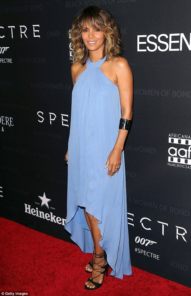 Brave face: Halle Berry turned out for the Black Women Of Bond Tribute in Los Angeles Tuesday night in her first red carpet since her split with husband Olivier Martinez, with whom she has a two year old son Maceo