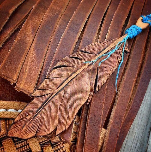Tooled leather feather