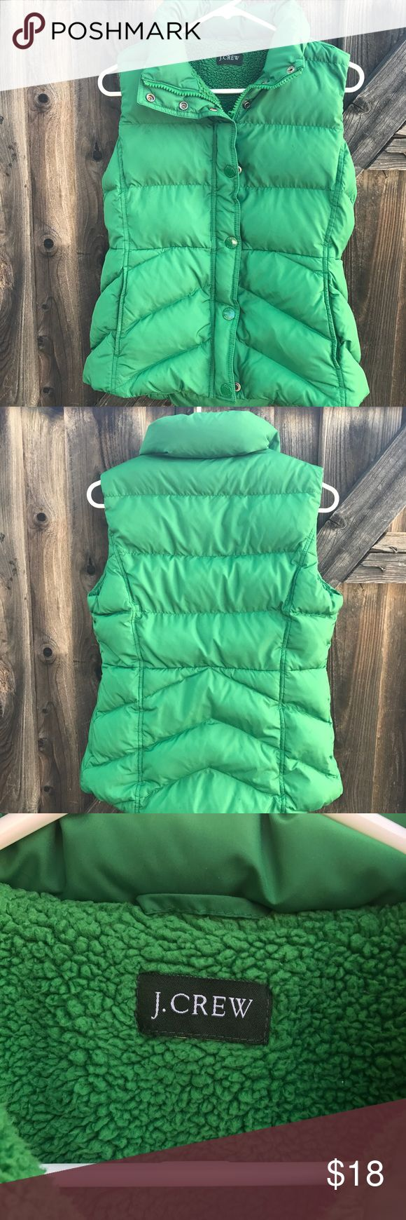 Jcrew women's vest Puffer Jcrew women's Puffer vest Size small Green with fleece lining  Made of 100% Polyester  Fill 80% down 20% water fowl feather No rips small stain on collar shown in picture Length 24 Armpit to armpit 19 Shoulder to shoulder 13.5 J.crew Jackets & Coats Vests
