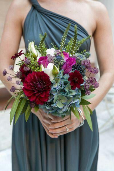 {Bridesmaid's Bouquet Of: Wine Dahlias, Dark Red Hellebores, Purple Astrantia, White Roses, Fuchsia Roses, Blue Nigella, Veronica, Blue-Green Jumbo Hydrangea, Green Foliage·················································}