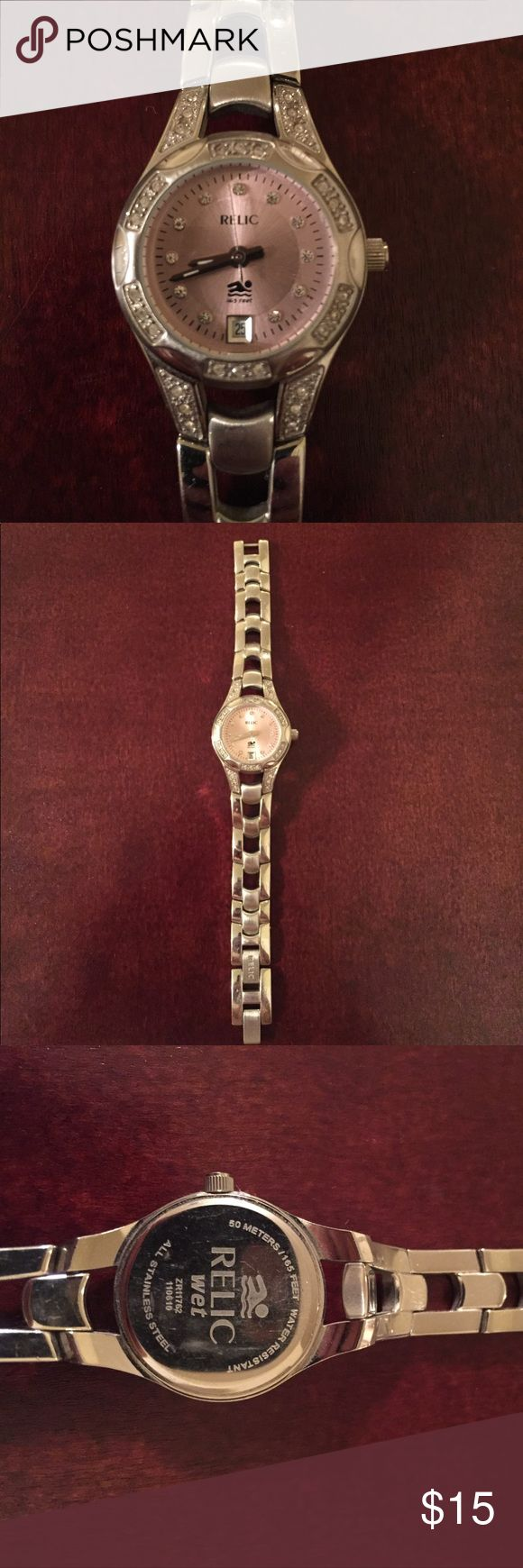 Silver Relic watch ⌚️ Diamond like stones around face. None missing. Needs new battery. Light pink face. In good condition. Relic Accessories Watches
