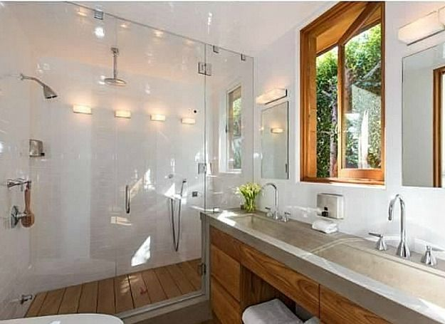 Love the materials, colours and use of space. But trough sink takes up too much bench space & wood slat floor in shower, wouldn't that get mouldy?