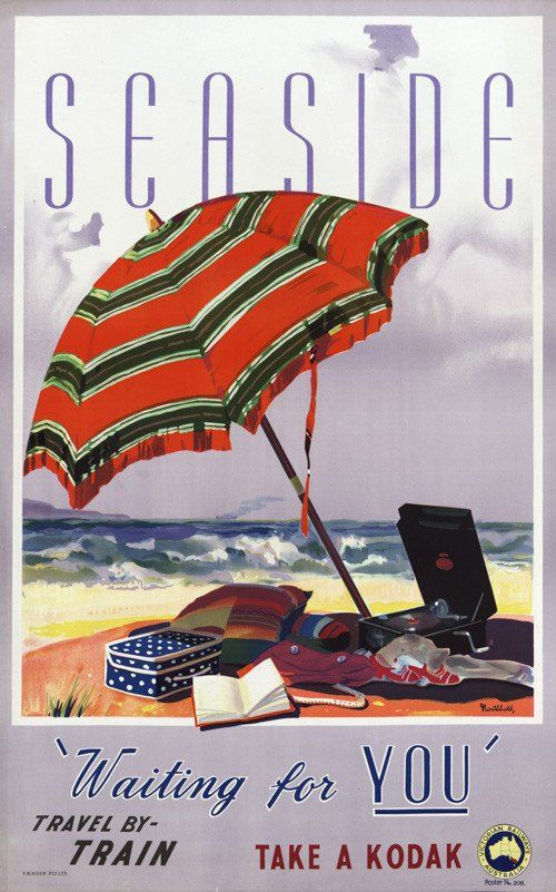 """Seaside. 'Waiting for you."""" Travel by train. Take a Kodak. A vintage Australian travel poster for Victorian Railways Australia shows a beach umbrella with a variety of objects for a day in the sun. Ci"""
