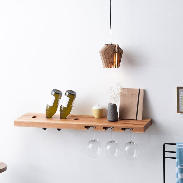 Simple wooden wine rack. Made of one piece of pear wood. It contains four bottles and six glasses.  image courtesy of MONOQI