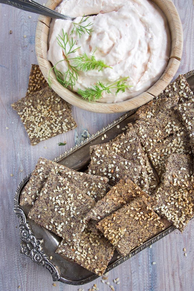These easy sesame Flax Crackers are super-crispy, grain free and high in protein. Great as an appetiser with dips such as smoked salmon taramasalata!