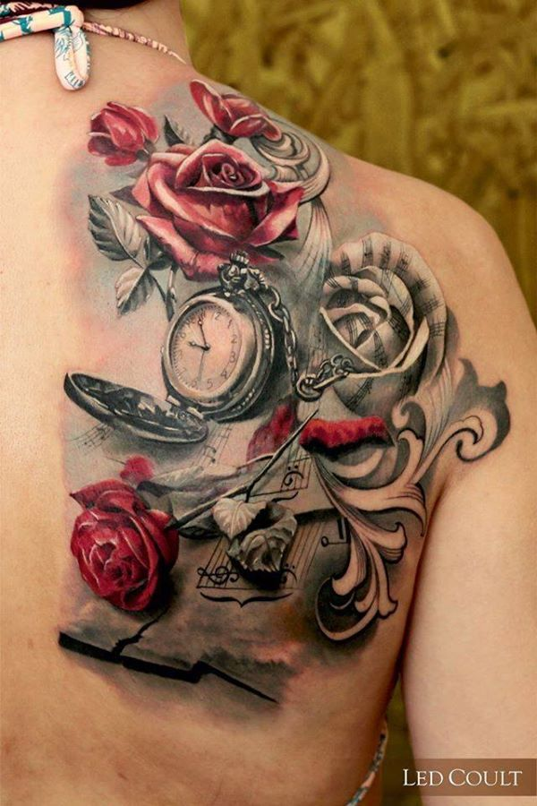 Rose themed realistic tattoo with a watch, music book. The symbolic objects in the tattoo create great space for imagination.