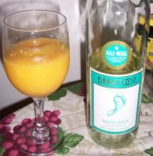 MOSCATO PEACHY MANGO - 7-8 frozen mango chunks; 5-6 frozen peach slices; 2/3 cup Barefoot Moscato -   Place peaches and mangoes into blender add wine and blend until you get a smoothie texture. Add more fruit or wine if needed to improve texture.  Pour into glass and garnish with a slice of peach or any fruit of your choice and enjoy!