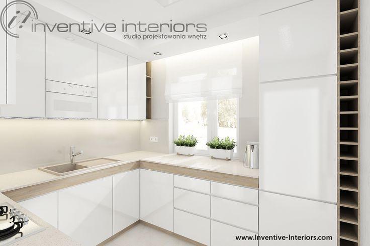 Projekt mieszkania Inventive Interiors - jasna kuchnia - biel beż i jasne drewno - półki na wino