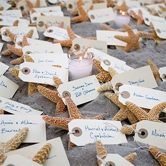 Handwritten Starfish Escort Cards. For a seaside take on escort cards, show guests to their seats with starfish place cards arranged casually on a bed of sand. Floral Designs by Perl, perlflowers.com.