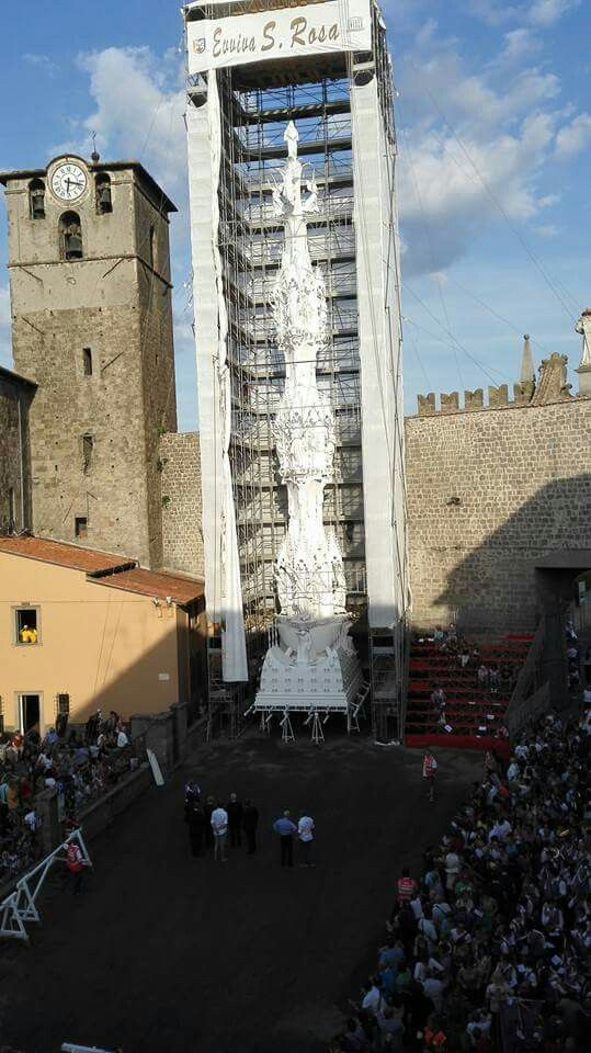 Santa Rosa...UNESCO: celebration of big shoulder-borne processional structures....since 1258...more than 100 Porters...30 meters high...about 5 quintals...a new structure every 5 years...