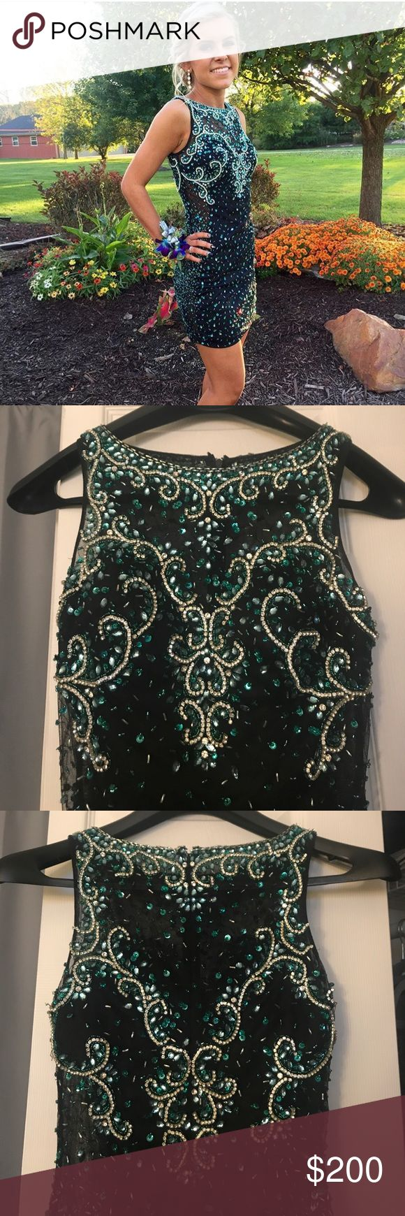 Karishma creations adiago party dress Black karishma party dress with silver and turquoise beading throughout the dress, small spot of beads missing price is adjusted considering that. Size 4 runs extremely small I am usually a 00/0 and because of heavy beading it is a very tight fit for a 4. Karishma Other
