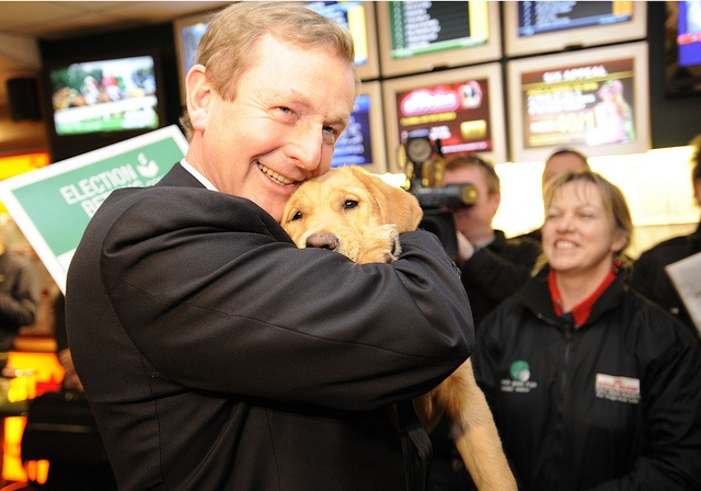 Fine Gael Leader Enda Kenny TD pictured  with Guide Dog Nikita while placing a charity bet that Fine Gael would take more than 70 seats in the 2011 General Election.  Proceeds on the 4:1 bet benefited Irish Guide Dogs for the Blind.