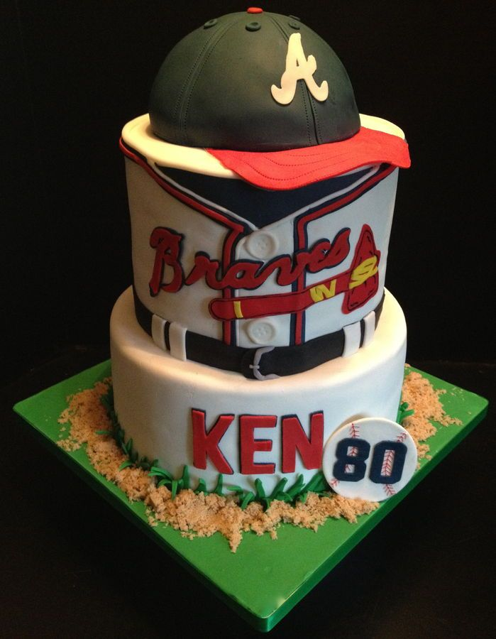 Atlanta Braves baseball birthday cake. Cap is done with the wilton sport ball pan. All fondant.