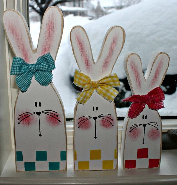 Hand cut and painted set of 3 white Easter bunnies. Largest bunny measures 91/2 x 3 inches and the smallest measures 7 x 2 inches. A checkerboard