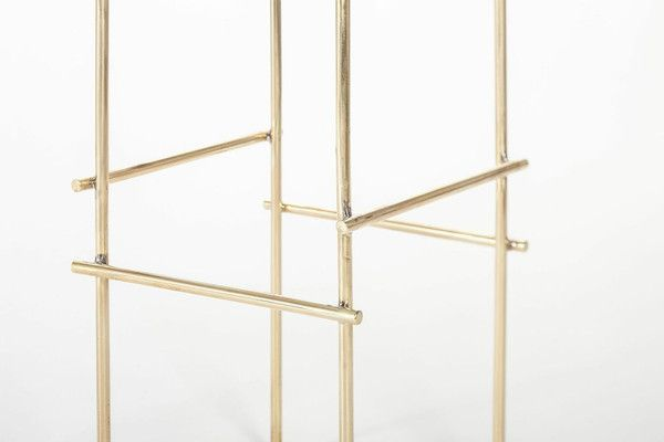 A combination of ultra clean lines and classic materials, theMarblelous Rackmakes astunning platform for anything from tomorrow's ensemble to your most tr...