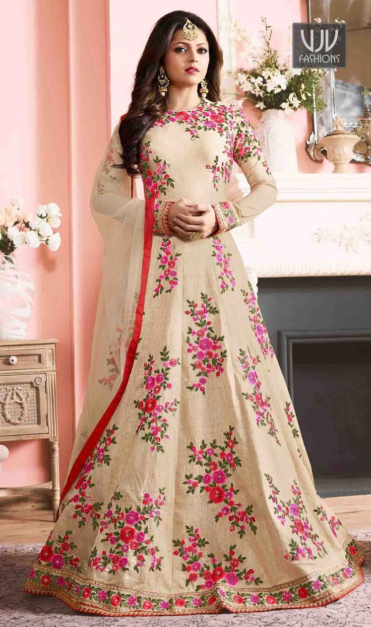 Drashti Dhami Cream Color Silk Designer Floor Length Suit  Look ethnic in this sort of a affluent cream color silk designer floor length salwar suit. The wonderful embroidered and print work a significant attribute of this dress.