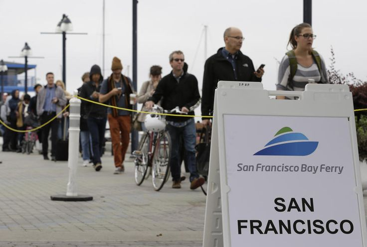 With the BART transit system on strike, people wait in line to catch a ferry to San Francisco Monday, Oct. 21, 2013, from Jack London Square...