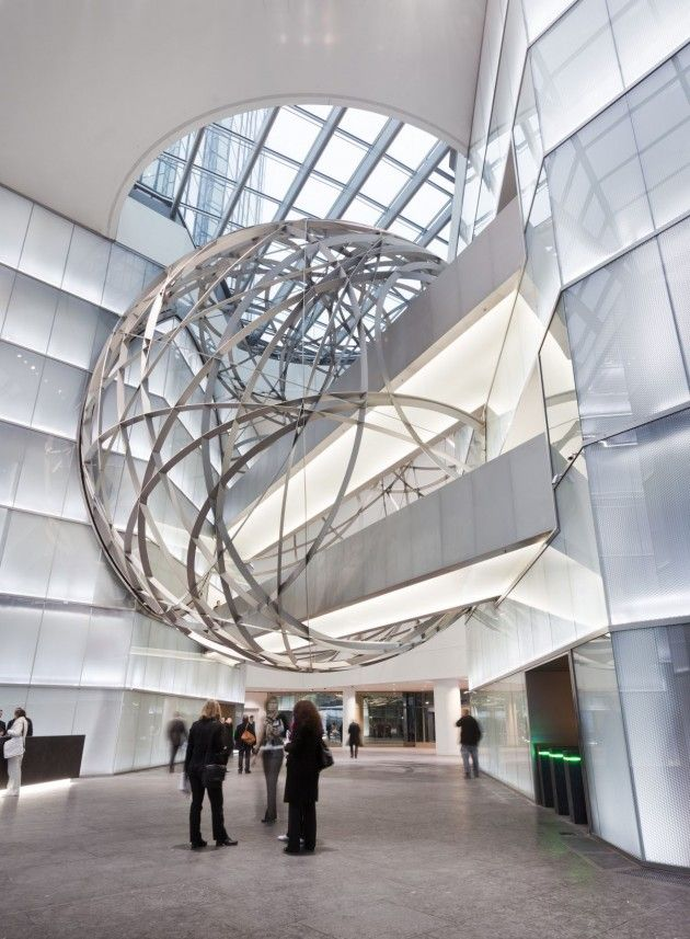 Mario Bellini Architects designed a large sphere made of steel inside the entrance to the new Deutsche Bank headquarters in Frankfurt, Germany.