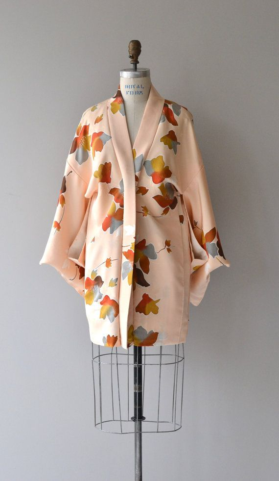 Vintage peach silk haori with geometric floral and center ribbon tie. ✂-----Measurements  fits like: one size fits most length: 32 brand/maker: n/a condition: excellent  ✩ vintage lingerie ✩ http://www.etsy.com/shop/DearGoldenVintage?section_id=7337122  ✩ visit the shop ✩ http://www.DearGoldenVintage.etsy.com