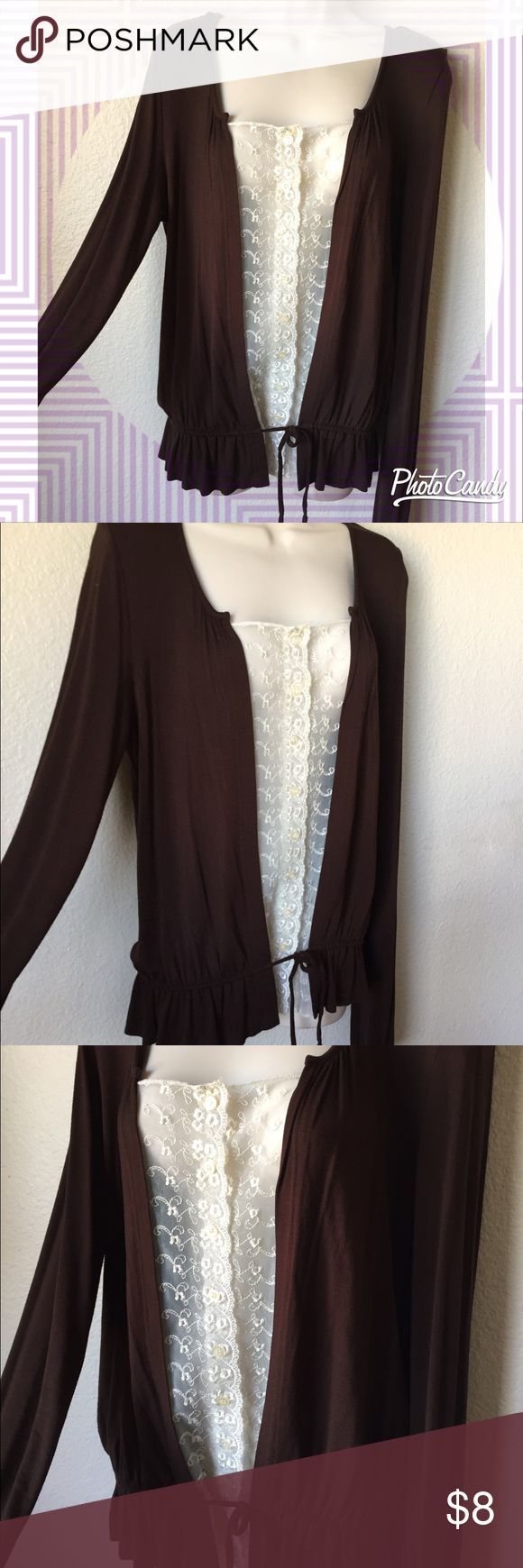 Brown and cream long sleeved top! I love this top! Very cute and has a boho feel and is comfy and lightweight... has a sheer lacy details down the middle with functional buttons as well as a drawstring bottom.. great condition! Size medium Tops Tunics