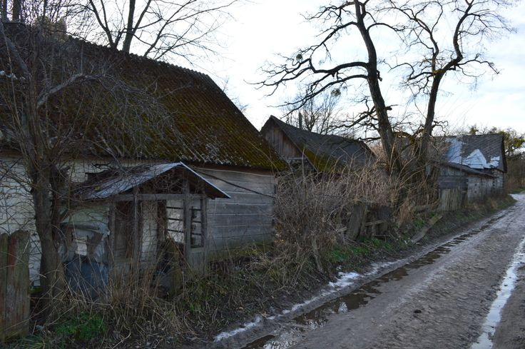 Long abandoned 18/19th century wooden & brick farm houses in the polish countryside...