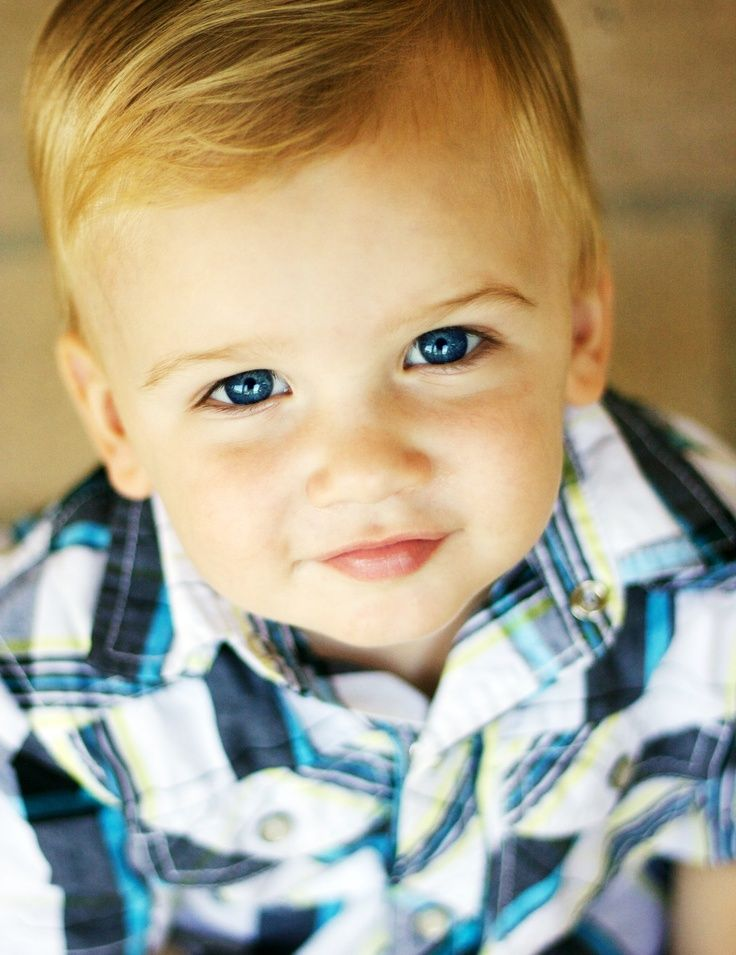 Toddler Boy With Blue Eyes And Brown Hair