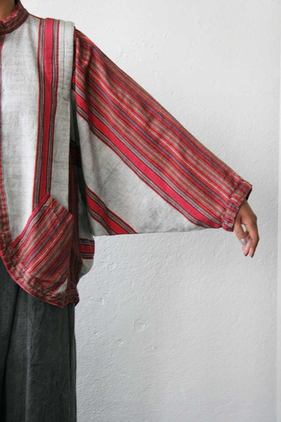 konstruction, Look what one can do with stripes. Batwing, front curved band, pocket