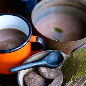 Jamaican Chocolate Tea. Basically hot chocolate made with water, and sugar and milk or cream can be added to taste.
