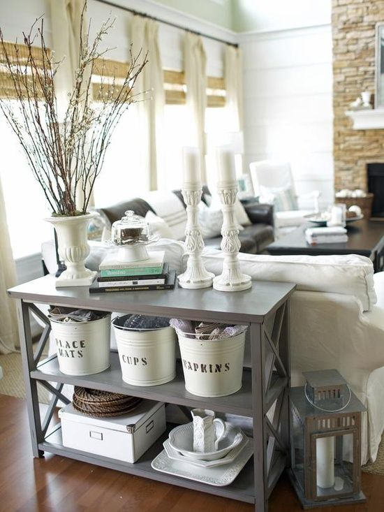 like the stone fireplace and white...the shelf with white storage containers is cool too.