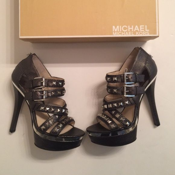 Last Day❄️❄️Amazing Michael Kors Heels Silver studded heels new in box by Michael Kors. Zips in back. Perfect for a night out and so gorgeous in person. Size 7 MICHAEL Michael Kors Shoes Heels
