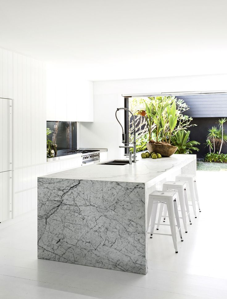 """The kitchen opens to a lush courtyard garden.   Carrara marble on **benchtop** from [BK Stone](http://www.bkstone.com.au/