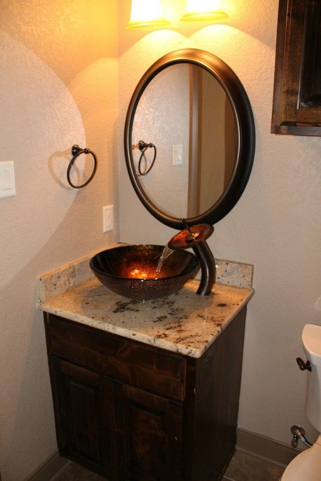copper glass bowl sink, brown marble vanity, dark wooden cabinet, round mirror of What You Do on Small Bathroom with Vanities and Sinks