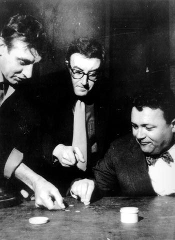 Masters of comedy: Spike Milligan, Peter Sellers and Harry Secombe, cast of the classic Goon Show here competing in a tiddlywinks tournament