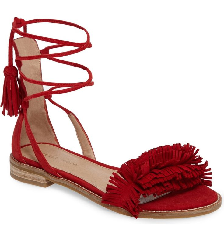 Fringe meets flats. These leather gladiator-inspired sandals with wraparound straps are statement making