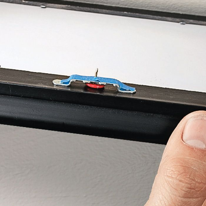 Tired of guessing at the location when installing picture hangers on the wall? The problem can be solved by applying tape to the frame's hanger, and then pushing a thumbtack through the tape as shown here. Perfect Placement. Next, position the frame and push the tack into the wall to get a precise hole for mounting your picture hanger. Remove the tape and the tack, and you'll be able to hang the frame exactly where you wanted it.