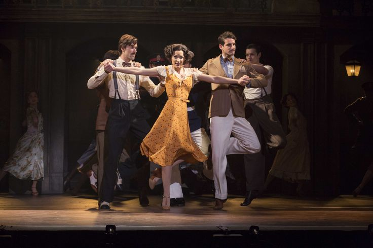 Caroline Bowman as 'Eva' and cast in the National Tour of EVITA. Photo Credit: Richard Termine