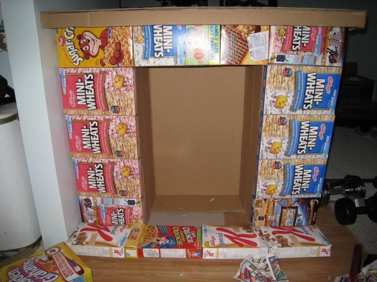 Static: fireplace from cereal boxes--The stockings were hung by the fake chimney...