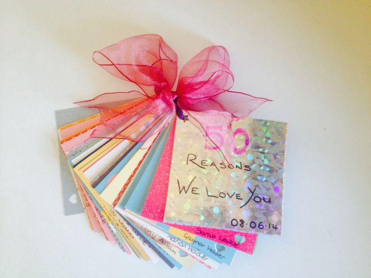 """50 reasons we love you book - 50th birthday gift - homemade gift of reasons collected from family and friends, all written on 4"""" square pieces of card and tied together with ribbon"""