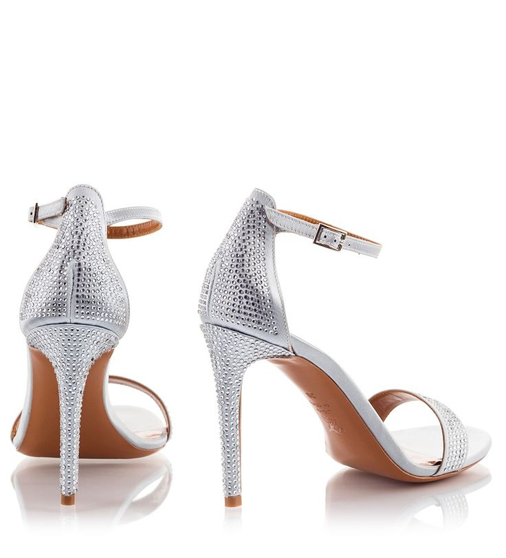 Fratelli Karida's sandals have been impeccably crafted in Italy from silk-satin. This timeless silver pair, is set on an elegant high heel that is covered with micro-studs. They're finished with a slim ankle buckle fastening strap, ensuring a secure fit. Wear them to events with flawless dresses.