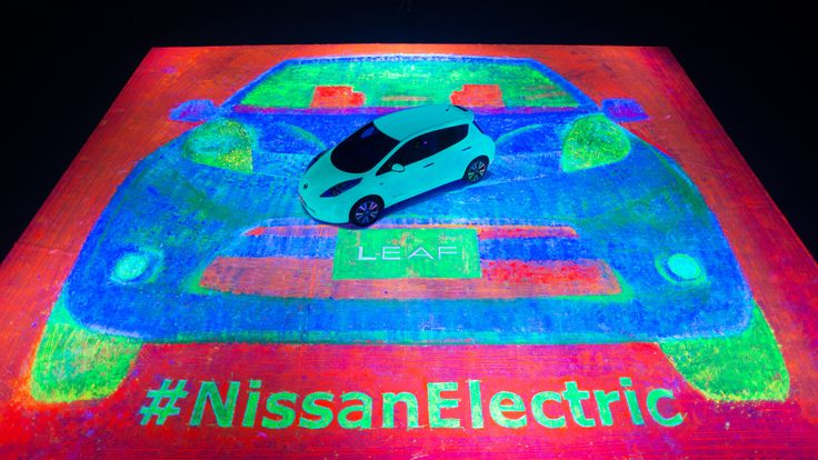 An Artist Uses the Wheels of a Glowing Nissan LEAF Car to Create the World's Largest Glow-in-the-Dark Painting