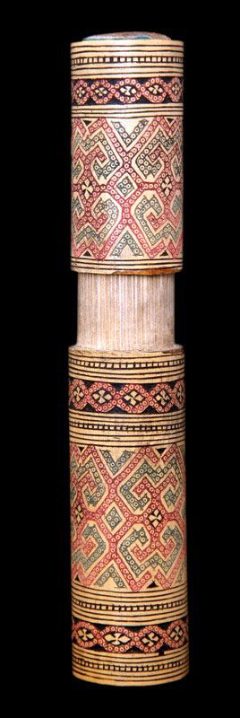Carved Bamboo Lime Container. Lime paste is one of the three ingredients for making betel quid, the other two being a leaf from the vine of the piper betel pepper plant, and thin slices of the areca-nut.   Chewing the mixture of areca nut and betel leaf is a tradition, custom or ritual which dates back thousands of years from South Asia to the Pacific. It is not known how and when the areca nut and the betel leaf were combined together into one psychoactive drug. Location: Timor, Indonesia.