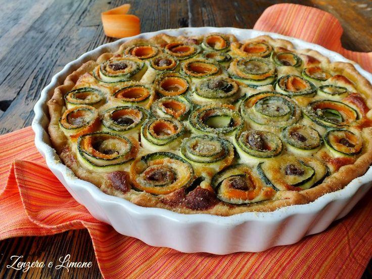 Questa torta salata di zucchine e carote è un gustoso piatto unico, buono da mangiare e bello da presentare in tavola. Perfetta quando si hanno ospiti.