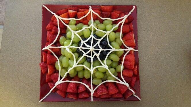 Spider fruit tray. This was easy and tons of fun. Cut top off and sliced strawberries in half. Then grapes and blueberries for contrast. Used half of my pinned buttercream frosting recipe and piped it on when the frosting was freshly made, nice and soft. HUGE hit at the spiderman party. Totally doing this again at Halloween.