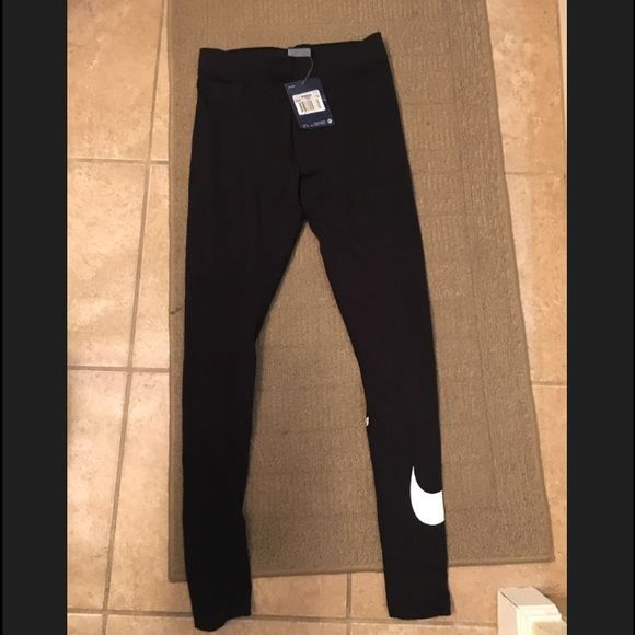 Women's Nike leggings! NWT Women's Nike leggings with a white swoosh on the left leg. Have never been worn and are in perfect condition! Very nice leggings! Size XS! Open to offers!  Nike Pants Leggings