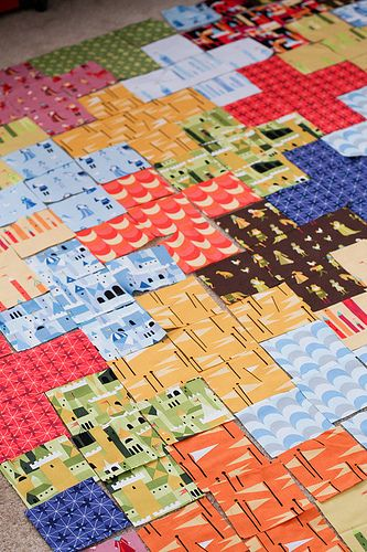 I am totally doing this with all those squares I've been stashing away....Plus Quilt Tutorial